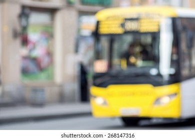 the abstract unsharp digital photo of the image of bus on city streets for indistinct empty and pure backgrounds
