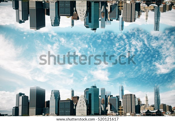 Abstract upside down cityscape  on sky background. Wallpaper/backdrop with copy space