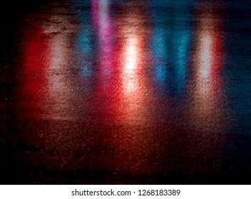 Abstract urban background. Lights and shadows of New York City. NYC streets after rain with reflections on wet asphalt