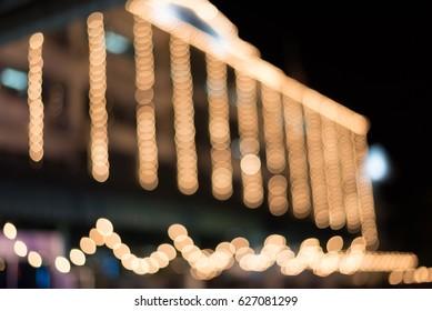 Abstract urban building night light bokeh, defocused background.