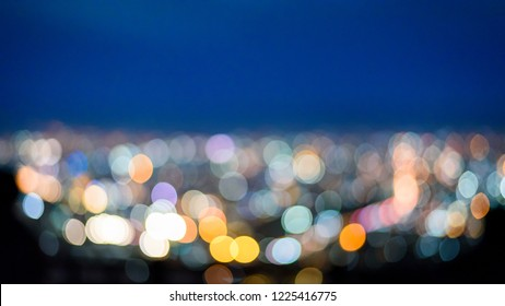 Abstract urban city night light bokeh background from the view point on top of mountain , Chiang mai , Thailand