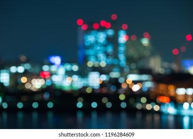 Abstract urban night light bokeh defocused background, city night Yokohama, Japan. Beautiful bokeh from light cityscape.