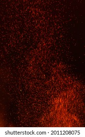 """Abstract, """"van Gogh"""" fire, a shower of bright red embers from a huge  fire fill a night sky, the swoops, swirls and streaks of the red embers resembling van Gogh's style, background"""