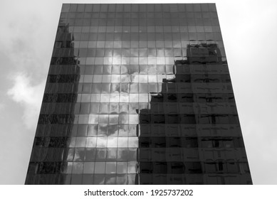 The abstract view of black color modern skyscraper with reflections in Miami downtown (Florida).
