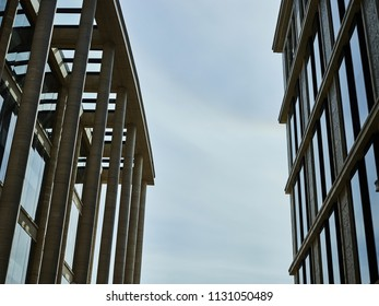 Abstract view of contemporary buildings with modern facades design placed against each other
