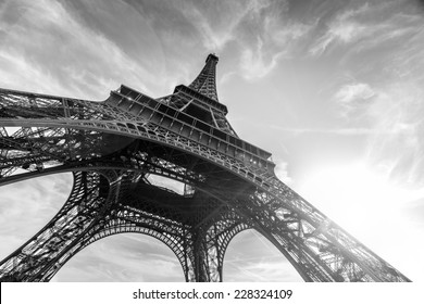 An abstract view of an Eiffel Tower against Sun in black and white colors, Paris, France