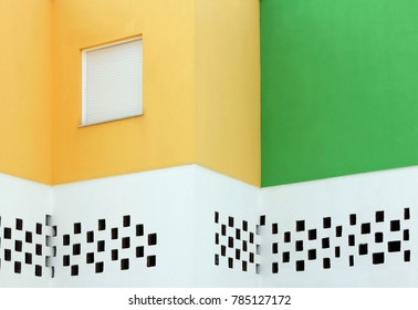 Abstract view of facade of Mediterranean house painted in traditional colors with copyspace.
