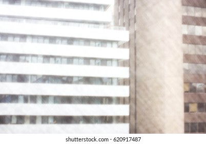 abstract view of modern versus old architecture through a window screen