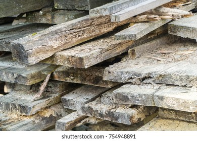 Abstract view on old stacked or piled sawn tree trunks.