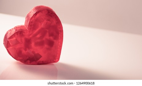 Abstract view of red love heart shaped soap on table love and romance concept.