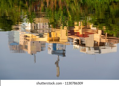 Abstract view of reflection of buildings and trees on water