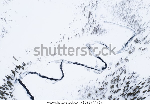 Abstract view to river between two fells in winter landscape, Lapland Finland