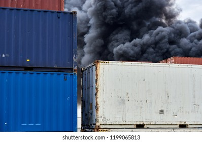 Abstract view of shipping containers with plumes of toxic smoke from an industrial fire rise up into the sky.