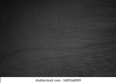 Abstract vignette black wood texture high quality close up. Dark furniture plank material wallpaper. Blank grunge wooden grain surface be used design as background or board luxury floor copy space.