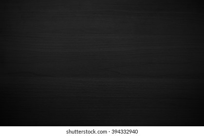 Abstract vignette black wood texture background. Dark furniture plank material wallpaper.