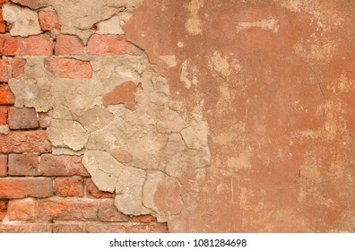 Abstract vintage textured old painted red brick wall with stained and shabby uneven plaster  background