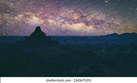 Abstract vintage tone long exposure photography of Ancient temple in Bagan, Myanmar in the night time with milky way and stars on the night sky background.