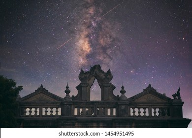 Abstract vintage tone long exposure photography of The Ancient Temple in Bagan, Myanmar in the night time with milky way and stars on the night sky background.