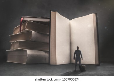 Abstract vision of a businessman standing in front of a huge book with blank pages
