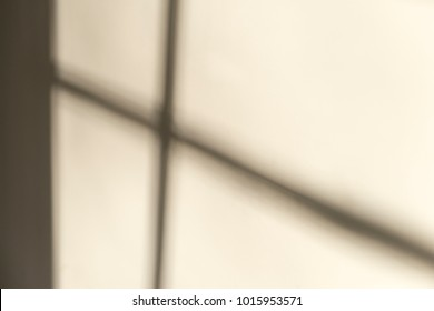 Abstract wall with shadow of window