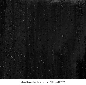 Abstract water drop on surface of  shiny black background