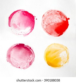 Abstract watercolor hand painted background on paper texture. Pink, red and yellow stains.