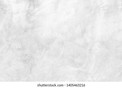 Abstract weathered texture stained old stucco light white and aged paint concrete wall background in the room.