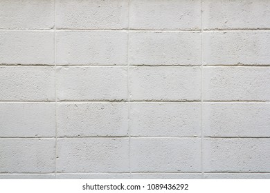 Abstract weathered textured white cement wall background.