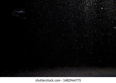Abstract white blurred dust explosion on a black background