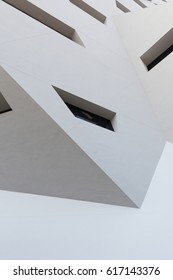 Abstract white building exterior with some windows