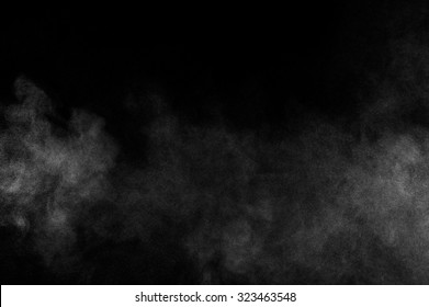 abstract white dust explosion  on a black background.