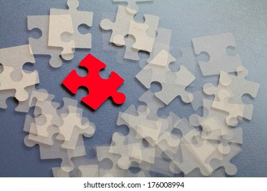 Abstract white group puzzle with red accents