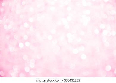 Abstract white and pink holiday twinkled bright background with natural bokeh defocused  lights. Festive.