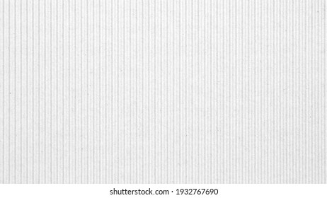 Abstract white recycled paper vertical lined texture background.  Old Kraft box craft paper stripes pattern seamless.  top view.