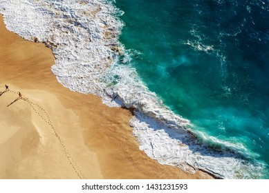 Abstract white sand beach with turquoise tropical sea water , aerial drone shot. Kelingking Beach in Nusa Penida Bali, Indonesia.