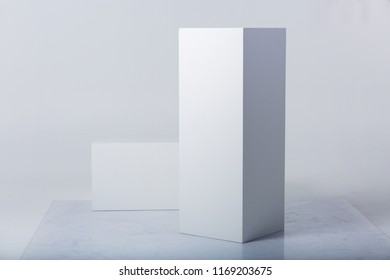 Abstract white shapes on a white backgrounds
