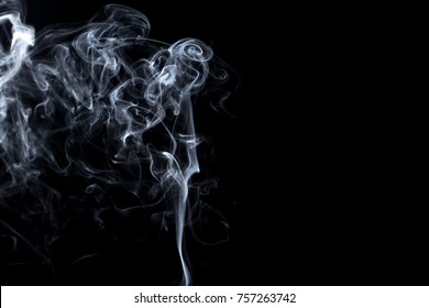 Abstract, white smoke isolated on black background. Isolate