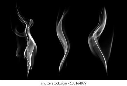 Abstract white smoke swirls on black background.