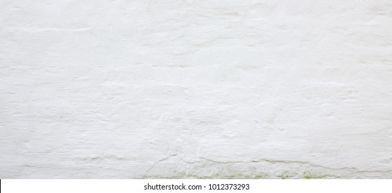 Abstract White Texture. White Washed Old Brick Wall With Stained And Shabby Uneven Plaster. Painted White Grey Brickwall Background. Home House Room Interior Design. Horizontal  Wallpaper