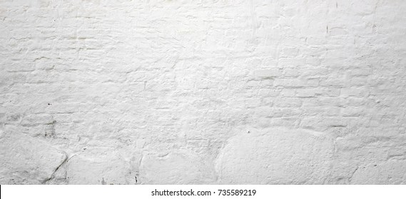 Abstract White Wide Brick Wall Texture. White Washed Old BrickWall With Stained And Shabby Uneven Plaster. Painted White Grey Stonework Background. House Room Interior Design. Horizontal  Wallpaper