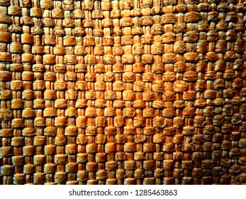 Abstract wicker pattern background. Weave texture close up. Detailed wicker or rattan handcraft. Brown rustic rattan wood wall macro. Seamless texture woven wooden rattan farm basket, wicker wallpaper