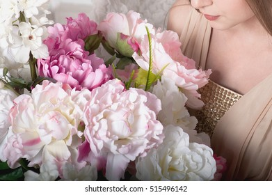 abstract woman with bouquet flowers vibrant in hands, warm tone, soft focus and blur