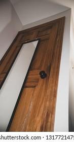 Abstract wooden room door with with empty mirror