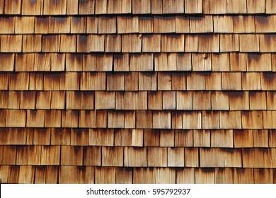 Abstract wooden texture of cedar shingles in Austria