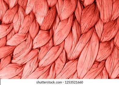 Abstract woven mat texture background living coral color. Trendy concept color of the year.
