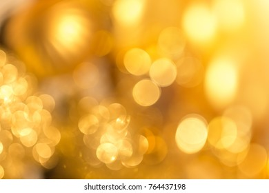 Abstract xmas Gold sparkles or glitter lights. Christmas festive gold background. Defocused lines bokeh or particles. Template for design