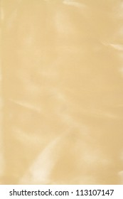 Abstract yellow background fabric,cloth, silk texture satin or velvet material.