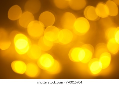 Abstract yellow bokeh background. Abstract gold bokeh background.