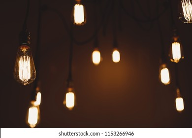 Abstract yellow bokeh background. Night life in the big sity. Lounge bar. Light bulbs in the interior of a restaurant or cafe.