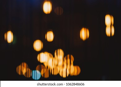 Abstract yellow bokeh background. Bokeh urban blurring colours concept. Night life of a big city. Lounge bar.